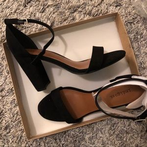 Never worn black strapped heels
